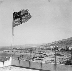 Reggio, 3 September 1943 (Operation Baytown): The White Ensign flies over Reggio harbour
